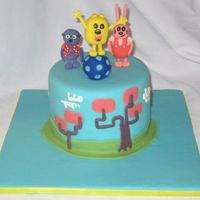 Wow Wow Wubbzy Yellow cake with Chocolate BC filling. Covered in MMF and GP figures. Ball made from Rice Krispy covered in MMF. Thanks for looking!