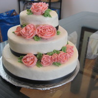 Tiered Cake I need to keep practicing my tiered cakes so that they come out a bit more leveled. It was all made out of buttercream, except for black...