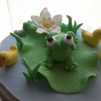 Fondant Frogs And Duckies On Lilly Pad   top of a baby shower cake for a baby named Lilly!!