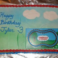 Thomas And Friends   Birthday cake for my son's birthday party. A wind up train went on the track.