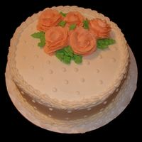 Ivory Bc With Peach Flowers   Made this cake after my first Wilton class was completed. Surprised my boss with it for his anniversary with his wife.