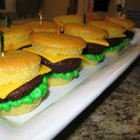 Cheeseburgers.jpg I tried my hand at the cheeseburger cupcakes. They were so fun to make and everyone thought they were real cheeseburgers at first!