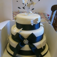 3 Tier Wedding Cake ivory and black wedding cake with butterflies and crystals