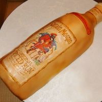 Captian Morgan's Bottle 3-D Captian Morgan's Spiced Rum made out of carrot cake, covered with creamcheese icing and fondant. used air brush to spray gold on...