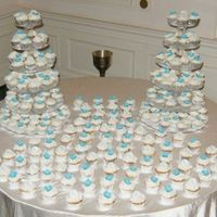 Blue Hydrangea Cupcake Wedding Cake 250 Cupcake wedding cake (white, carrot cake and red velvet). The blue hydrangeas are handmade out of gumpaste. The white circles with the...