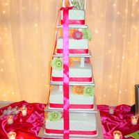 "Cake1.jpg This is my first fondant wedding cake. It was 5 tier in sizes 14"", 12"", 10"", 8"", & 6"" on the top. The fondant..."