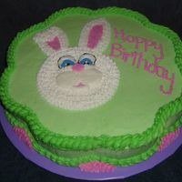 Bunny White buttercream bunny on green background