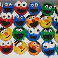 Sesame Street Cupcakes Buttercream frosting, oreo cookie mouths, marshmallow eyes, M&M noses and ears. Super fun to make! View my other cakes at http://...