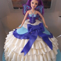 Barbie Cake This is my first Barbie cake. My daughter and I had so much fun making her. It is a Carmel cake with Macchiato cream filling and covered in...