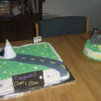 Engagement Cake  This is my engagement cake. My family let me make it for myself! It's marble cake with fudge BC filling. Covered in BC, fondant road,...