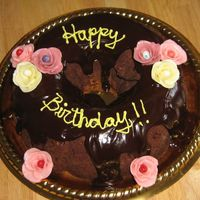 Bundt Cake Tunnel of fudge bundt cake...covered in chocolate ganache. Starburdt roses...I let the jellybeans show too much, but I still like them...at...