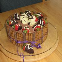Pirouline Cake Devil's food filled with chocolate mousse (janh recipe). Covered with chocolate BC and dipped strawberries. Finished off with...