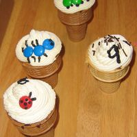 Ice Cream Cone Cupcakes Ice cream cone cupcakes, decorated with smarties to look like bugs for a boys 9th birthday.
