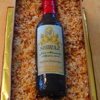 Wine Bottle & Crate Pina Colada Cake with toasted coconut for the packing material. RKT bottle covered in fondant and edible image. Crate is fondant &...