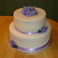 Quilted Bridal Shower Cake Fondant covered, quilted w/ purple fondant roses.