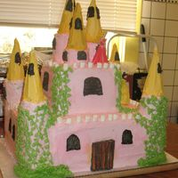 Fairy Prinsess Castle Cake devil's food and yellow cake with buttercream frosting.