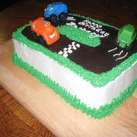 Race Car Cake I made this cake for my sons 1st birthday, it's chocolate and yellow, 2 layer cake with whipped cream frosting.