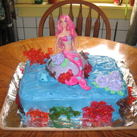 Little Mermaid Cake This is Devils food and yellow cake with rock candy coral. I made rock candy and poured it over a ice in a deep bowl to get the shape of...