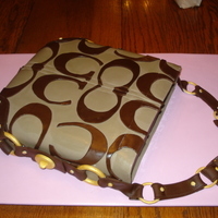 Leigh's Coach Purse Cake A birthday gift for my niece. My first attempt at a purse cake. Her husband sent me pictures of her favorite purse, and that's what I...
