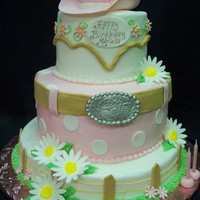 Girly Western Cake   Buttercream iced cake with fondant detailing. Cowgirl hat is cake with gumpaste brim.
