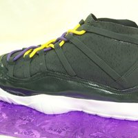 3D Tennis Shoe   Cake is covered with fondant; shine was achieved by painting the fondant with edible lacquer.