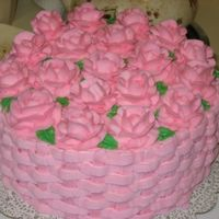Pink Rose Basketweave   This was a white cake with strawberry filling and buttercream frosting. It was made for a bridal shower.