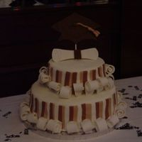 Tiered College Grad Cake   Fondant Cake. Cake is topped by a fondant diploma and grad cap. Design is from Wilton.