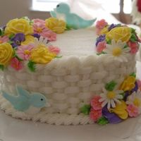 Wilton Class 2 Final Cake   Basketweave buttercream cake. Every since this class I've been in love with the basketweave design.