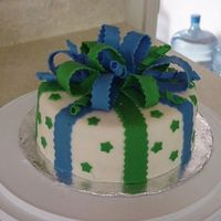 Present Cake   Fondant Bow cake. Made the bow out of fondant and gum paste. Cake is decorated with MMF.
