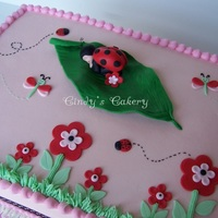 Ladybug Baby Shower 11x15 iced in buttercream with fondant decorations and gumpaste topper. Designed to match baby's room decor. TFL!!