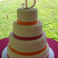 Fushia & Orange 6/9/12/14 rounds iced in fondant with royal icing scrolls and fondant ribbon. TFL!!!