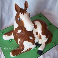 Kim's 3D Horse Carved cake iced in buttercream to resemble customer's actual horse.. Fondant hooves, ears & eyes. RKT for the head and lower half...