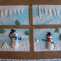 Snowmen In The Window iced in buttercream with fondant icicles and window panes. buttercream snowflakes on the sides. inspired by aldoska's awesome cake....