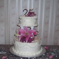 25Th Anniversary Fresh Flowers on 2 tier cake w/ pillars. Very simple design. I thought those drop strings would be the death of me!!! They kept breaking &...