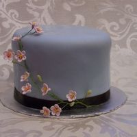 Blue Fondant With Cherry Blossoms Brown ribbon Border. 1st attempt at gp flowers!