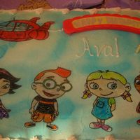 "Little Einsteins Rocket, & Little Einsteins drawn on wafer paper and filled in with colored piping gel. ""Happy Birthday"" sign lit up and..."