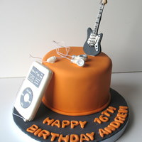 Musician Birthday Birthday cake for a musical teenager. ipod and guitar are made of gumpaste