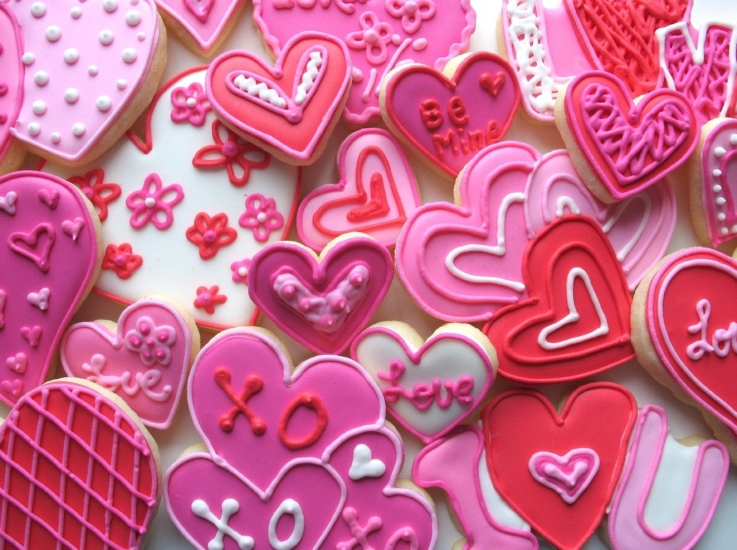 Valentine's Cookies These are valentine's day sugar cookies decorated with pink and red royal icing.