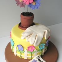 Garden Flowers This cake was inspired by a cake on Wilton's website. Three large gumpaste flowers on wires and all of the other decorations are mmf....