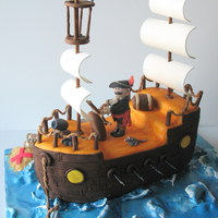 Pirate Ship Pirate ship carved cake. Covered in fondant with gumpaste sails and accents. Borrowed lots of ideas from CC members. Loved the idea of...