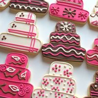 Pink & Brown Wedding Cake Cookies Wedding cake-shaped sugar cookies for a pink, brown and ivory wedding. All decorated with royal icing in unique designs