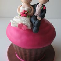 Cupcake Wedding Cake Large cupcake wedding cake with gumpaste bride and groom topper. This cake sat on top of a 3-tiered cupcake stand for a pink and brown...