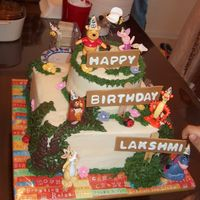Pooh Cake My First Tiered cake (except for wilton course III where I used the pillars). The toys kept on falling and I couldn't smooth the icing...