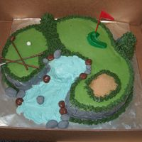 Golf Cake For my boss's birthday. Buttercream with fondant accents. Stick, ball and flag are plastic.