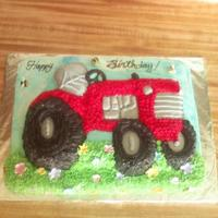 International Tractor Cake Sheet cake with Wilton' tractor cake pan. Fondant bees and flowers