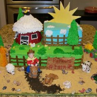 Parkers Farm And Farm Animals Farm scene with fondant farm animals, a little boy sitting on a horse, barn and a large colorflow sun.