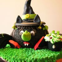 Wicked Bat Witch The cake was made using a pyrex bowl to form the body. Fondant was used to create the hat, ears, wings, red witchy high heel shoes, facial...