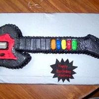Guitar Hero Guitar Hero cake. Carved from a 9 x 13 sheet cake, neck made of RKT. Covered in buttercream w/fondant accents