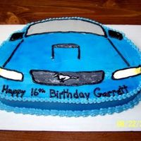 Garrett's Mustang My son's 16th birthday cake. He got a Mustang for his b/day so I made his cake to match. Carved from an oval cake, decorated in...