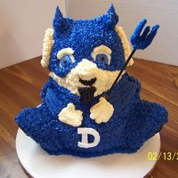 Duke Blue Devil Duke Blue Devil made from the stand up bear pan, carved and decorated to match Duke University's mascot.